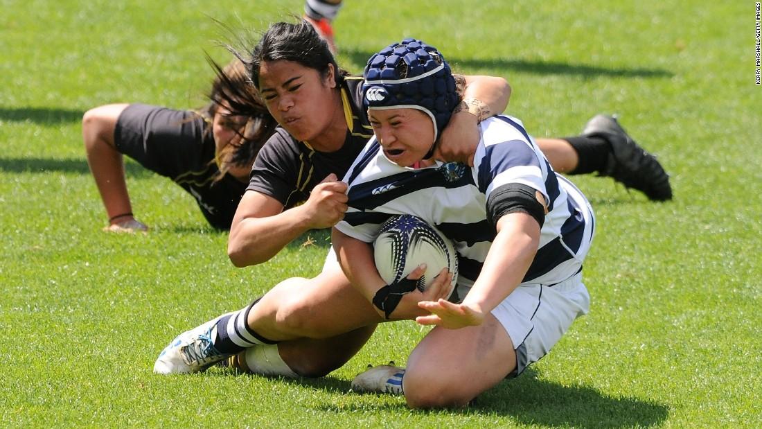 Auckland's Charmaine McMenamin is tackled while playing Wellington in the Provincial Championship final played Saturday, October 17, in Napier, New Zealand. Auckland won 39-9.