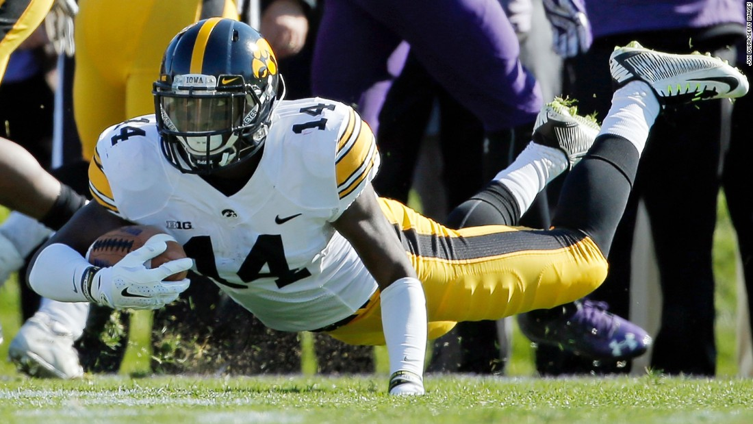 Iowa's Desmond King falls to the ground after intercepting a pass at Northwestern on Saturday, October 17. King has five interceptions this year for the undefeated Hawkeyes.