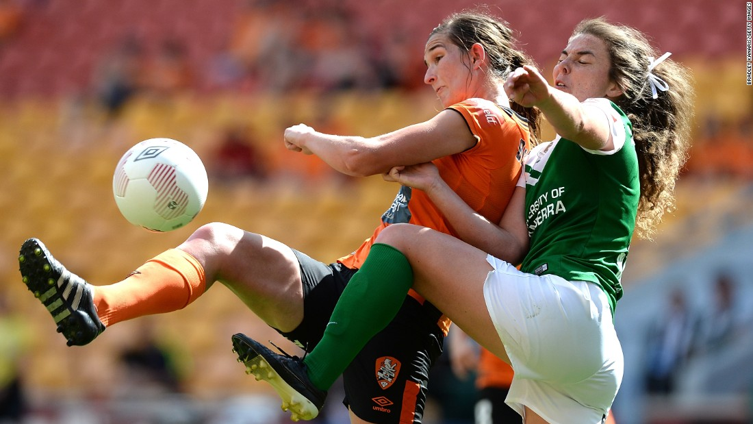 Brisbane's Ruth Blackburn, left, is challenged by Canberra's Jenna McCormick during a W-League match in Brisbane, Australia, on Sunday, October 18.