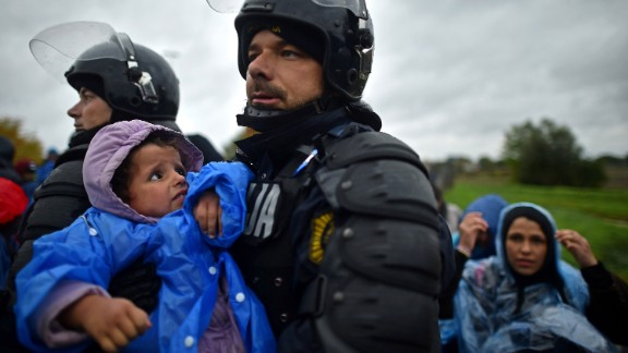 Slovenian police helped some of the people who were stuck in cold and wet weather in Trnovec.