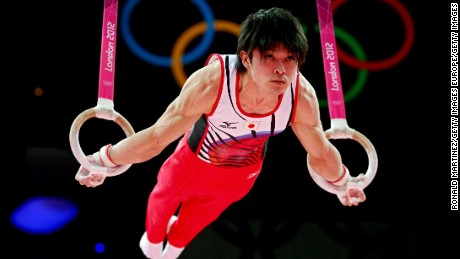 LONDON, ENGLAND - AUGUST 01: Kohei Uchimura of Japan competes on the rings in the Artistic Gymnastics Men's Individual All-Around final on Day 5 of the London 2012 Olympic Games at North Greenwich Arena on August 1, 2012. (Photo by Ronald Martinez/Getty Images)