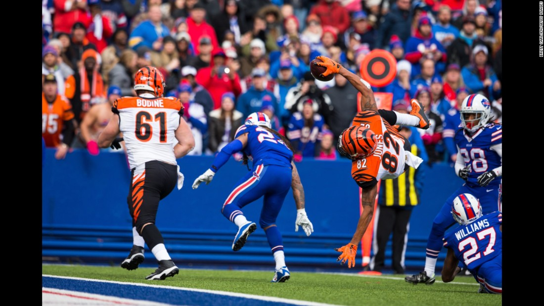 Cincinnati wide receiver Marvin Jones flips into the end zone after being hit by Buffalo's Duke Williams on Sunday, October 18. Jones had nine catches for 95 yards as the Bengals improved to 6-0 on the season.