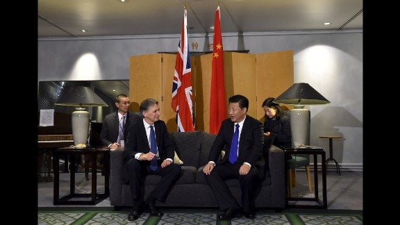 British Foreign Secretary Philip Hammond sits with Xi at Heathrow Airport after Xi's arrival on Monday, October 19.