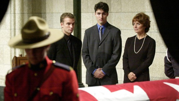 From left, Sacha, Justin and their mother, Margaret, look over Pierre Trudeau
