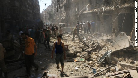 Syrians check the rubble following an airstrike in Aleppo last month.