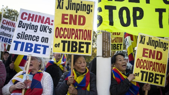 Pro-Tibet protesters hold placards and chant slogans as they demonstrate on Parliament Square in London on October 20.
