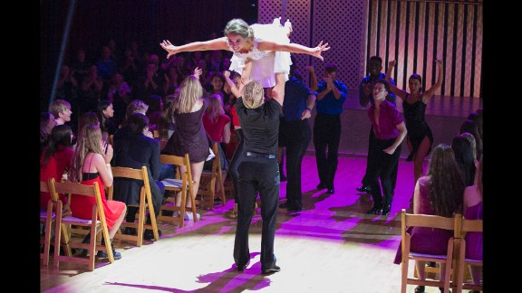 "DANCING WITH THE STARS - ""Episode 2106"" - The remaining nine celebrities returned to their original professional dance partners to tackle ""Famous Dances Night"" on MONDAY, OCTOBER 19 (8:00-10:01 p.m., ET) on ABC's ""Dancing with the Stars."" Special guest Olivia Newton-John joined the judges' desk to see how the couples re-created iconic dance routines from movies and music videos. One couple was eliminated at the end of the night based on the lowest combined judges' scores and viewer's votes from the ""Switch Up"" and ""Most Memorable Year"" performances. (ABC/Adam Taylor)