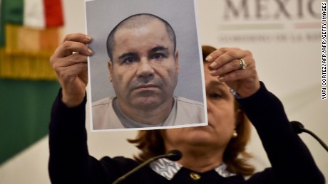"Mexico's Attorney General Arely Gomez shows a picture of Mexican drug kingpin Joaquin ""El Chapo"" Guzman during a press conference held at the Secretaria de Gobernacion in Mexico City, on July 13, 2015. Guzman managed to escape from his cell despite a monitoring bracelet and 24-hour security camera surveillance, and likely was helped by prison officials, authorities said. AFP PHOTO/ Yuri CORTEZ        (Photo credit should read YURI CORTEZ/AFP/Getty Images)"