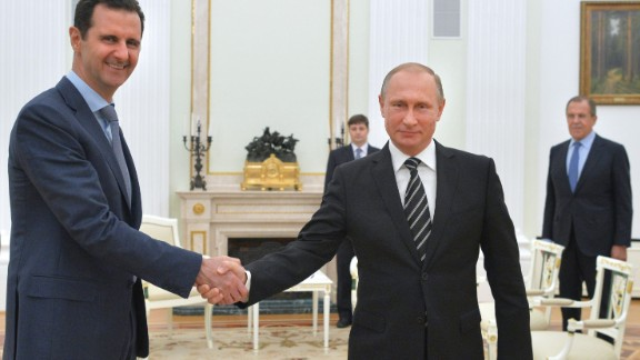 Russian President Vladimir Putin (R) shakes hands with his Syrian counterpart Bashar al-Assad (L) during a meeting at the Kremlin in Moscow on October 21, 2015. Assad, on his first foreign visit since Syria