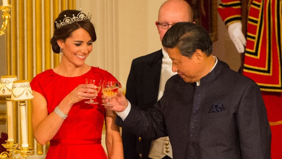 Xi and the Duchess of Cambridge raise their glasses at a state banquet at Buckingham Palace on Tuesday, October 20.