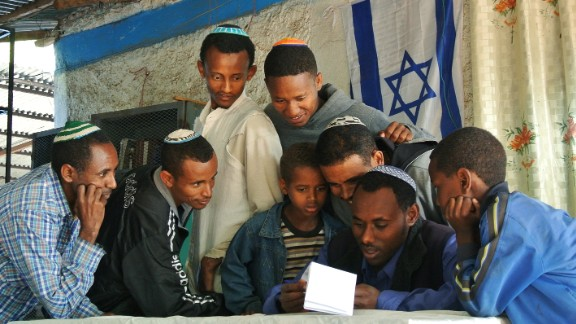 Ethiopian Jews gather at a makeshift synagogue in Gondar, Ethiopia, to see if they have been given a date to move to Israel on November 19, 2012.