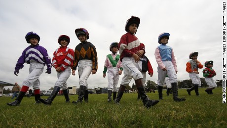 PLUMPTON, ENGLAND - OCTOBER 19: Jockeys make their way to the parade ring for The Moorcroft Racehorse Welfare Centre Shetland Pony Gold Cup at Plumpton racecourse on October 19, 2015 in Plumpton, England. (Photo by Alan Crowhurst/Getty Images)