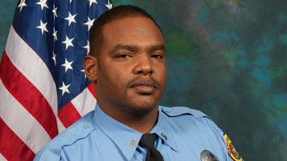 This undated photo provided by the City of New Orleans shows Officer Daryle Holloway.  The New Orleans Police Department said Holloway was shot while transporting a suspect, Travis Boys, who managed to get his handcuffed hands from behind his back to the front, grab a firearm and shoot the officer. A manhunt was underway for the 33-year-old Boys, according to Police Chief Michael Harrison.  (City of New Orleans via AP)