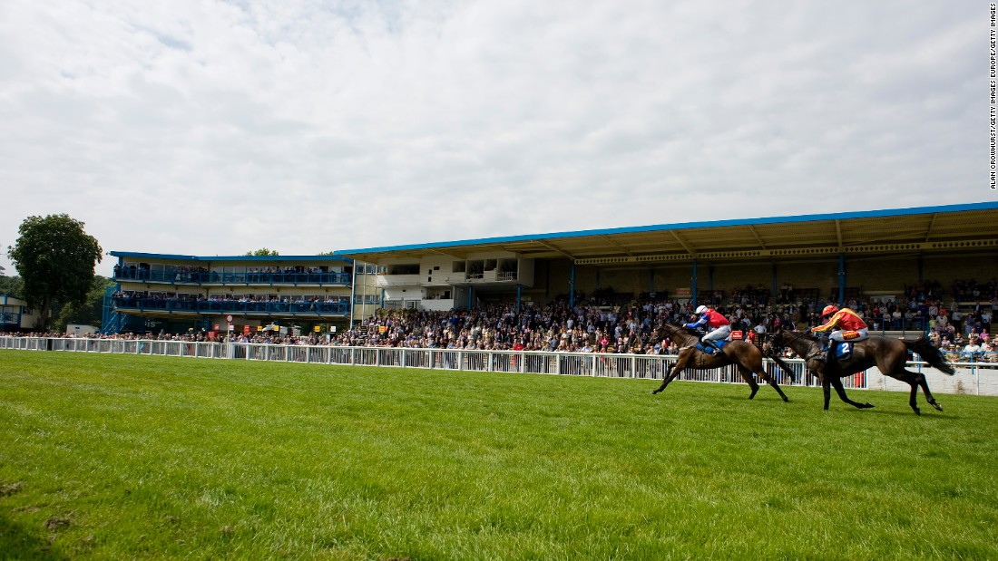 Donal Fahy riding Dark Spirit (left) wins The Green Taveners Juvenile Maiden Hurdle Race at Newton Abbot racecourse in September, 2011. Newton Abbot is now a summer jump course only, with its season starting in March running through to the end of August/early September.