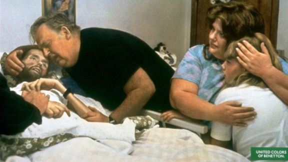 Taken by Therese Frare, this image shows the deteriorating condition of David Kirby -- an AIDS activist. The photo, taken in 1990, was captured in Kirby's actual hospital room in Ohio, and features Kirby's family members by his bedside. The image went on to win the World Press Photo Award in 1991.