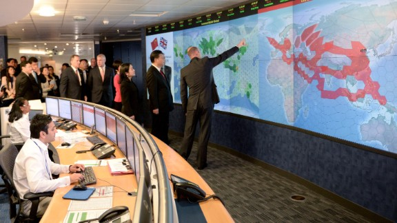 Xi views satellite coverage screens in the Network Operation Centre control room during a visit to Inmarsat, a satellite telecommunications company, in London on October 22.