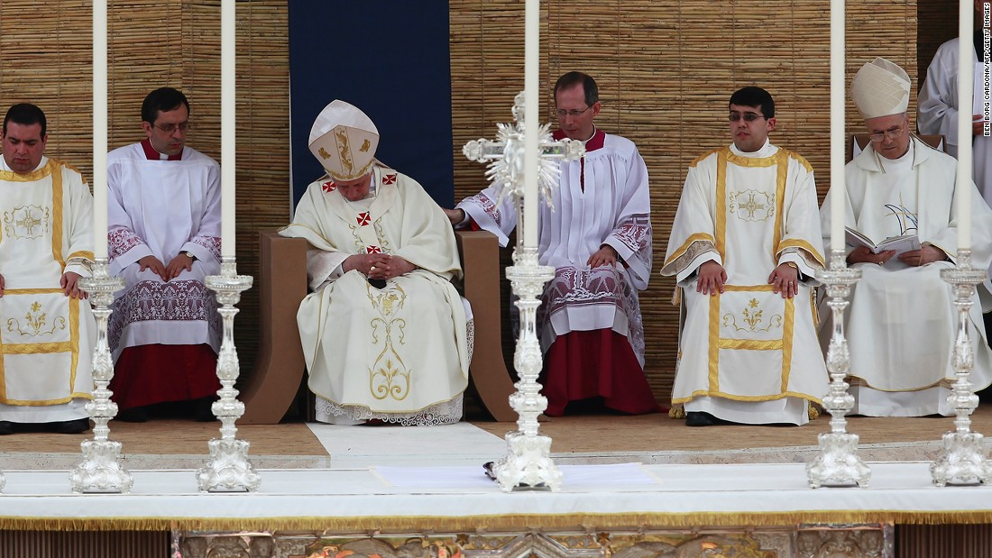 Pope Benedict XVI (C), 83 at the time, falls asleep during the celebration of a Pontifical Mass on the Granaries in April 2010 in Floriana.