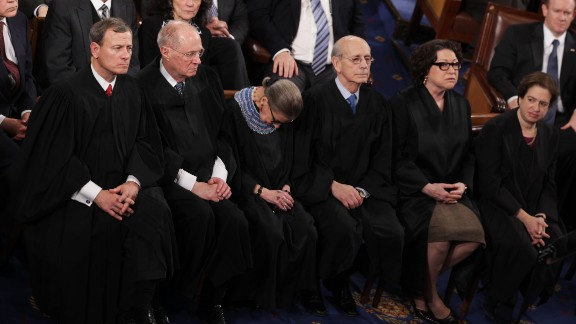 """Supreme Court Justice Ruth Bader Ginsburg (C) fell asleep during Barack Obama's State of the Union speech in January 2015. It wasn't the first time, she says. The reason? """"I was not 100% sober,"""" Ginsburg said, blaming fellow Justice Anthony Kennedy for bringing a bottle of red wine to their pre-speech dinner."""