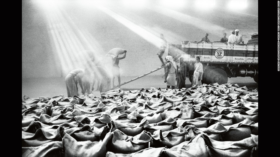 "Coffee farmers work at a warehouse in the Indian state of Karnataka in 2003. Sebastiao Salgado has images from 10 different countries in his new photo book, ""The Scent of a Dream: Travels in the World of Coffee."""