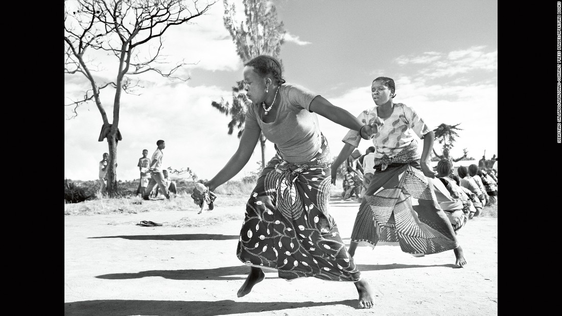 Coffee pickers dance in a Tanzanian village in the town of Mbinga, near Lake Nyasa, in 2014. Before coffee's eventual export, flawed or discolored beans must be removed by hand.