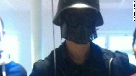 AFP received this photo purportedly showing a masked man with students.