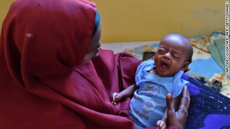 A mother with her baby who is suffering from pneumonia at the SAACID Stabilization Centre in Mogadishu, Somalia, on March 25.