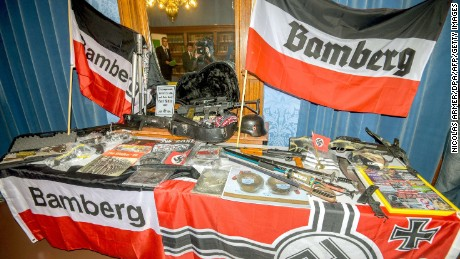 Seized firearms, other weapons, paintball guns and Nazi flags on display during a press conference of German police in Bamberg, southern Germany.