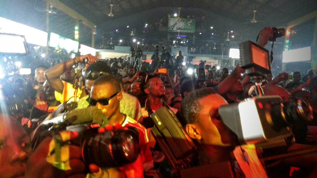 The number of cameras present demonstrates the draw that Fela Kuti still has.