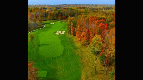 """Our second entry comes from @aerialagents. """"One of the most visually impressive holes on this Tom Fazio designed course,"""" they explain. """"Sand Ridge Golf Club is built on 370 acres of woods, pastures and wetlands."""" The vast array of colors in the trees are evidence of this."""