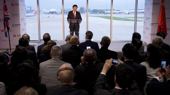 Chinese President Xi Jinping addresses an audience of dignitaries, including British Prime Minister David Cameron, at the Manchester airport in Manchester, England, on Friday, October 23. It was the end of a four-day state visit for Xi, who traveled to the United Kingdom with his wife, Peng Liyuan.