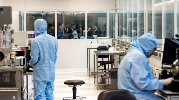 Xi tours the National Graphene Institute at the University of Manchester on October 23.