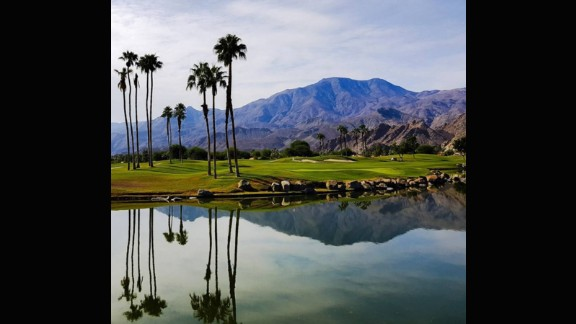 """At this course, you would be forgiven for deliberately aiming your ball towards the water hazard. The still, crystal water creates the perfect canvas to mirror the backdrop of palm trees and mountains. @channingbenjaminphotography described it as: """"The best!"""""""