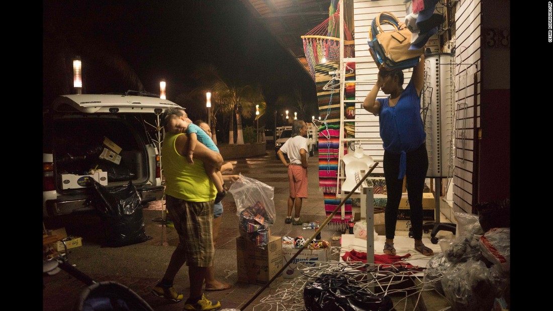 People break down their souvenir shop in Puerto Vallarta on October 22.