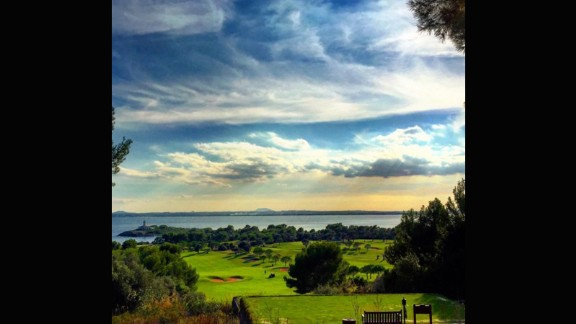 """This snap sent to us by @enderlix captures the sun's rays piercing through the clouds and into the Mediterranean Sea. """"The club takes its name from a nearby island just off the shore which, complete with its own lighthouse, can be seen from most of the holes,"""" the club says."""