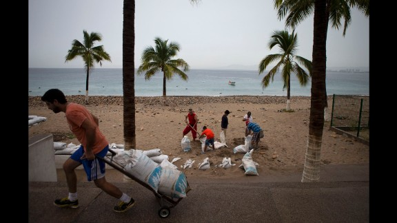 Residents fill sand bags to protect beachfront businesses in Puerto Vallarta on October 23.