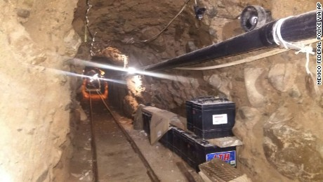 The tunnel includes a rail system, lights and metal-beam supports.