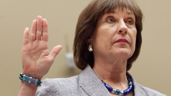 """WASHINGTON, DC - MAY 22:  Internal Revenue Service Director of Exempt Organizations Lois Lerner is sworn in before testifying to the House Oversight and Government Reform Committee May 22, 2013 in Washington, DC. The committee is investigating allegations that the IRS targeted conservative non-profit organizations with the words """"tea party"""" and """"constitution"""" in their names for additional scrutiny. Lerner, who headed the division that oversees exempt organizations, plans to assert her constitutional right not to answer questions.  (Photo by Chip Somodevilla/Getty Images)"""