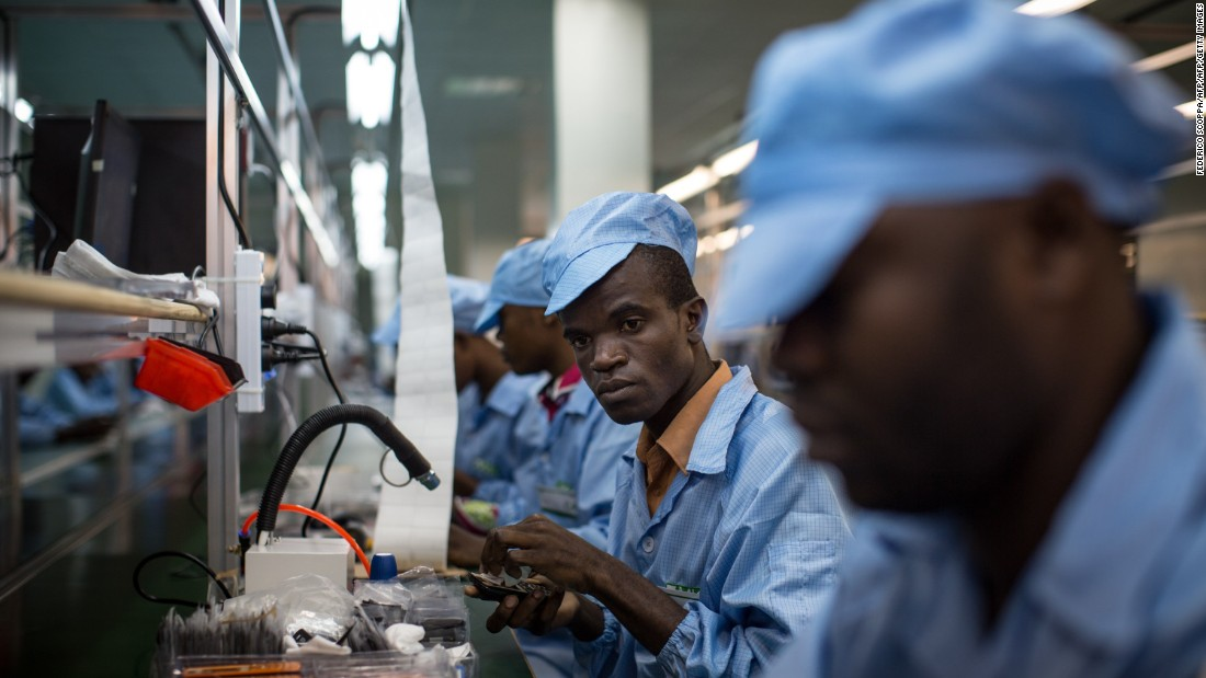 "In 2012, economic activity related to mobile phones and their life-cycle accounted for about 3.3 million jobs.<br /> <br />Pictured:  Employees work on mobile phones on the assembly line at the VMK (for ""Vumbuka"", ""Wake up"" in Kituba) factory in Brazzaville on July 20, 2015. The factory, run by Verone Mankou, produces the first mobile phones made in French speaking Africa."