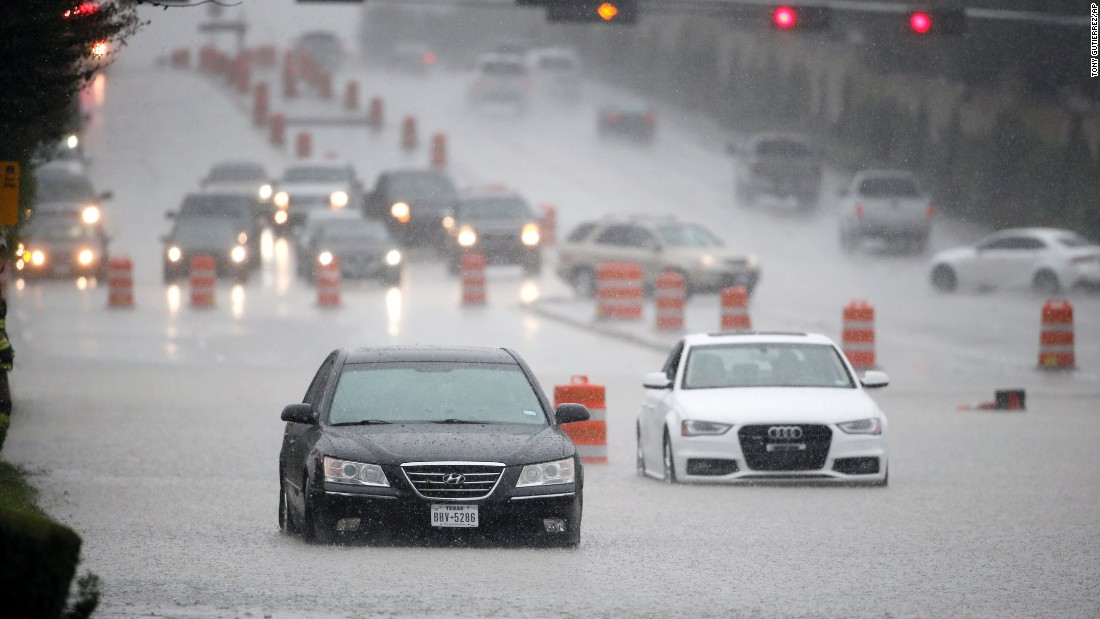 Vehicles stall in flood waters on Hillcrest Road during a heavy rainfall Friday, October 23, in Dallas.