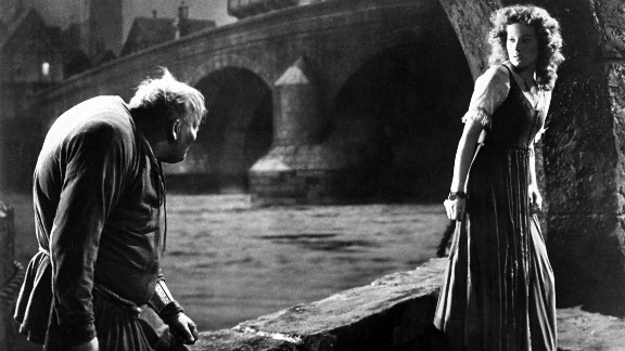 """Charles Laughton (Quasimodo) and Maureen O'Hara (Esmeralda) appear in """"The Hunchback of Notre Dame"""" in 1939."""