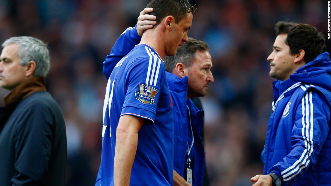 Nemanja Matic was sent off for a second yellow card and trudges past his manager Mourinho.