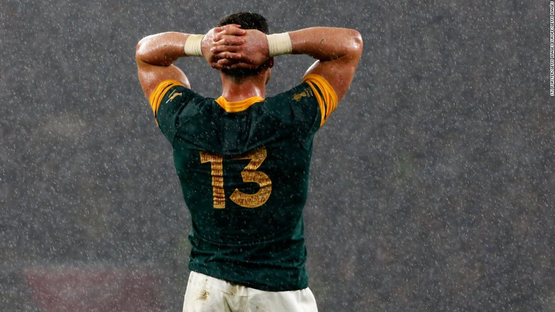 Despair in defeat. Jesse Kriel of South Africa cuts a forlorn figure as the rain pours down at Twickenham.