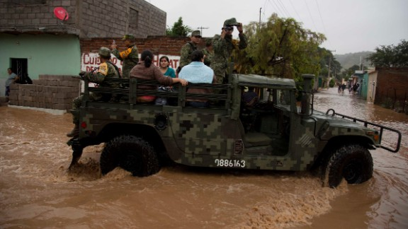 Soldiers evacuate residents to a shelter in Zoatlan on October 24.