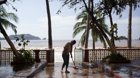 A worker cleans out the Monterey Hotel on October 24 in Melaque, Mexico.