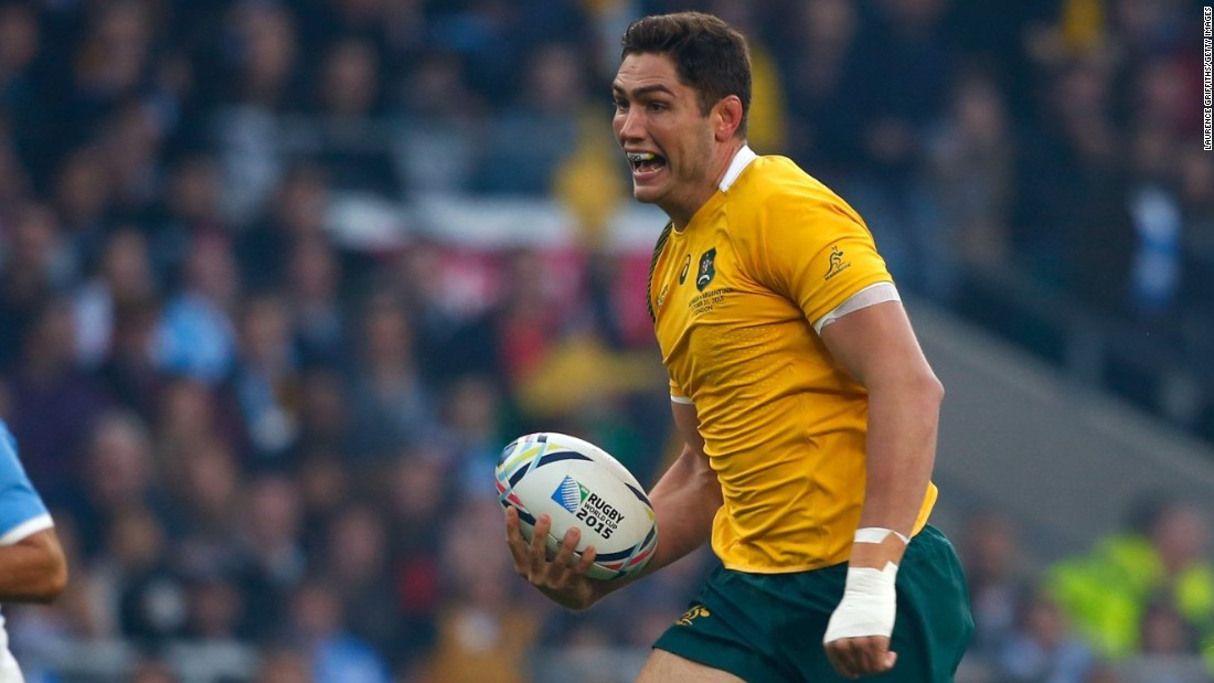 Rob Simmons of Australia races through to score the opening try of the World Cup semifinal against Argentina with just a few seconds on the clock.