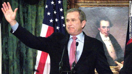 AUSTIN, UNITED STATES:  US President-elect George W. Bush waves farewell to supporters gathered in the Senate Chamber at the State Capitol in Austin, Texas 21 December 2000. President-elect Bush announced his resignation as Texas' governor before the audience.       AFP PHOTO/Paul BUCK (Photo credit should read PAUL BUCK/AFP/Getty Images)