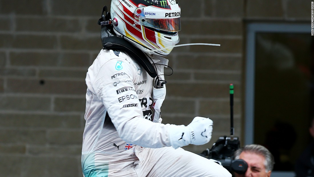 Lewis Hamilton jumps for joy after taking his third world title.