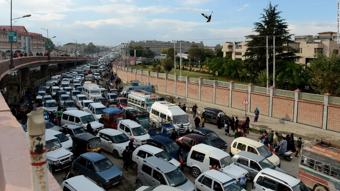 Stranded drivers wait in and around their vehicles in Srinagar, India, on October 26.