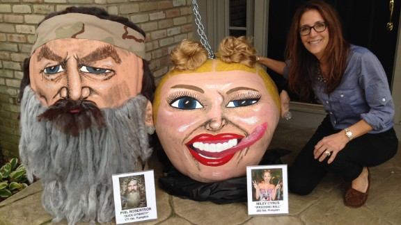 """When Miley Cyrus twerked on stage at the 2013 VMAs and made the news repeatedly for her appearances, she became fodder for a Paras pumpkin. """"Duck Dynasty"""" star Phil Robertson appears beside Cyrus, as his 2013 anti-gay comments led him to be suspended from the show."""