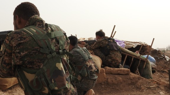 Kurdish YPG fighters fighting on the front line against ISIS.